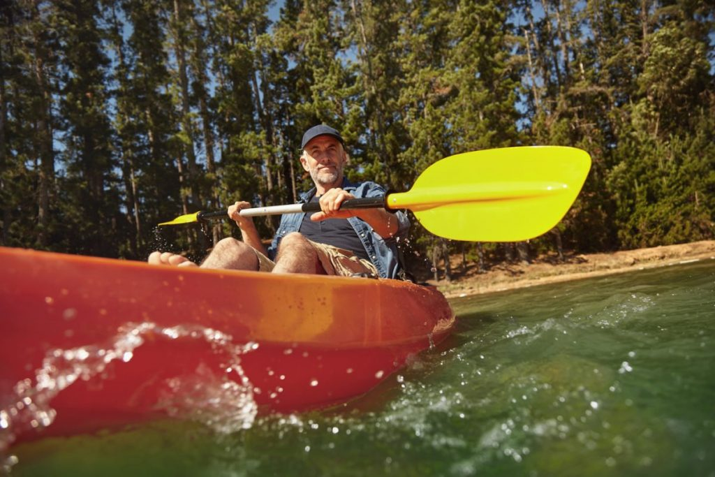 Mature man canoeing on summer day