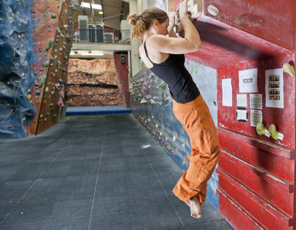 Climber practicing on indoor wall